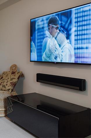 LG 60 inch tv Sonos playbar in bath