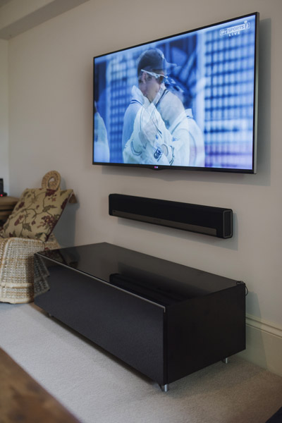 LG60 inch tv Sonos playbar Just Rack cabinet in bath