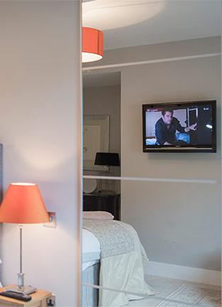tv on wall in bedroom installation